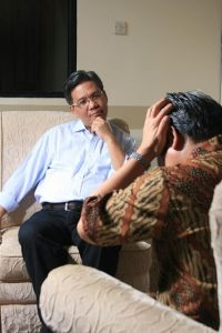 a person having a counselling session